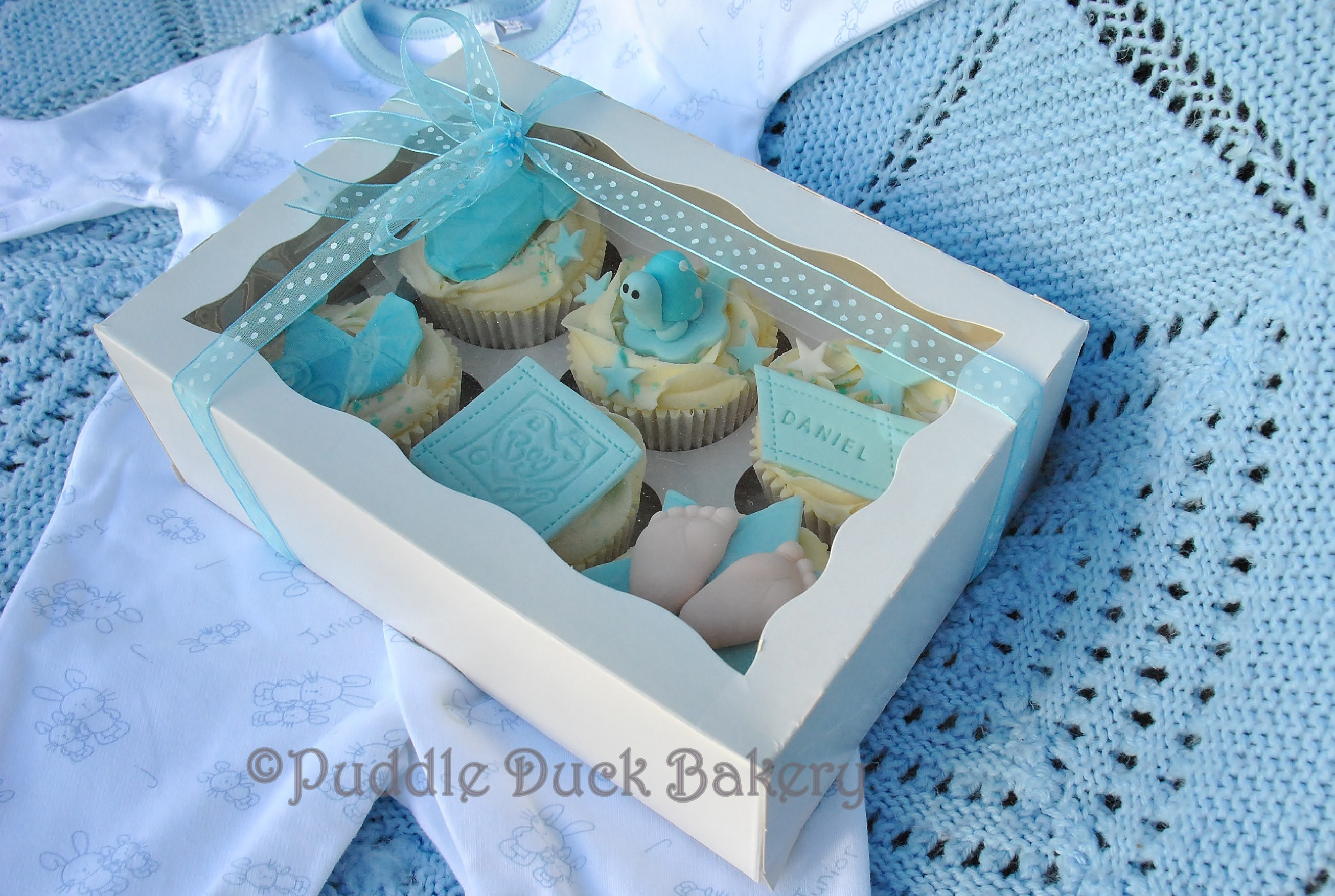 A display box with some cupcakes