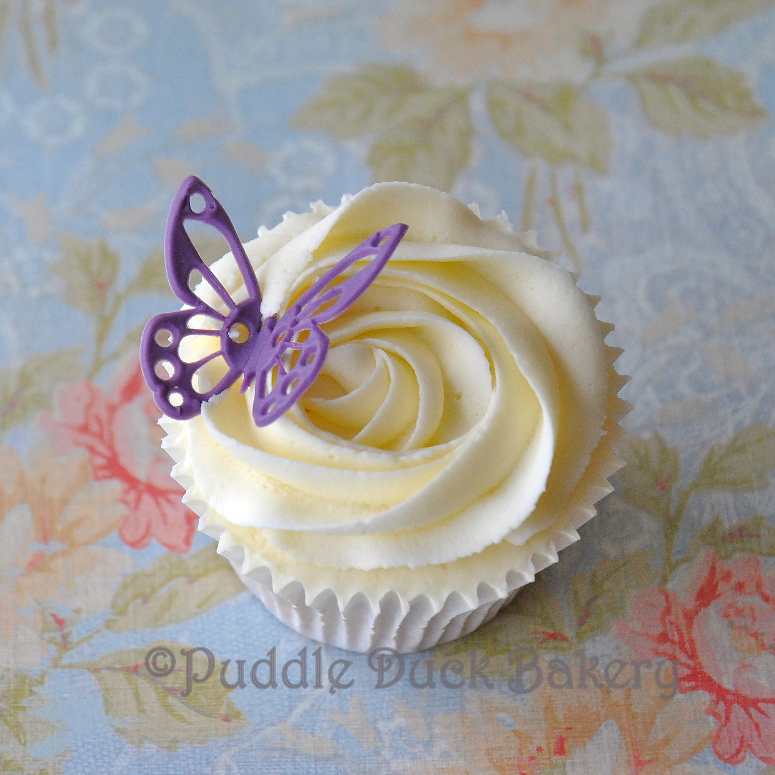 A purple butterfly on a cupcake