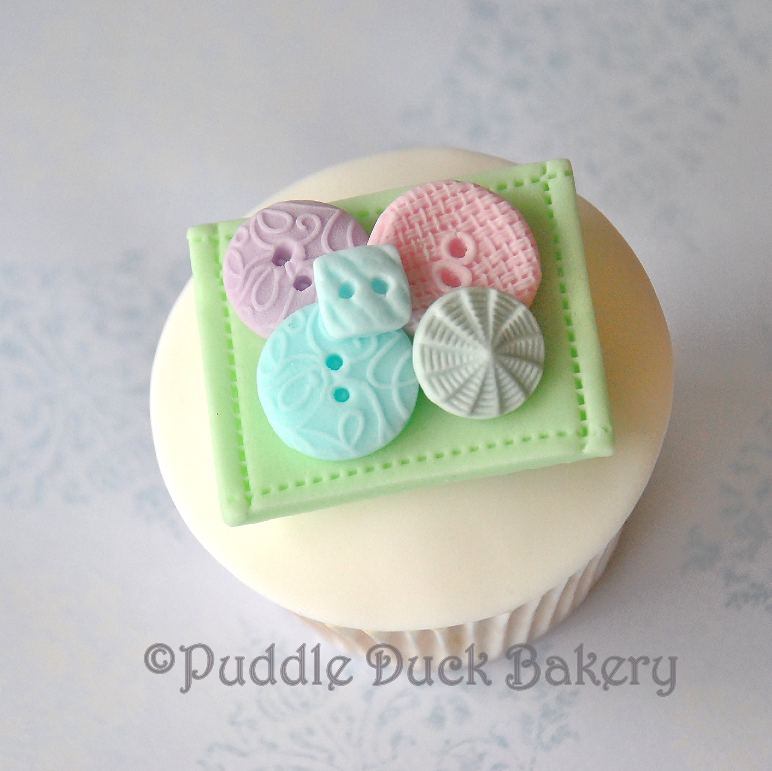 Textured buttons on a cupcake
