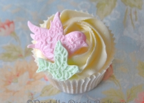 Gorgeous textured birds on a cupcake