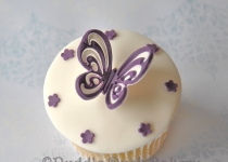 A butterfly with stars on a cupcake