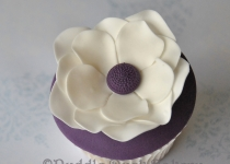 A beautiful flower with delicate petals on a cupcake.